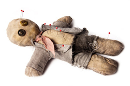 Photo of Businessman voodoo doll laying on white